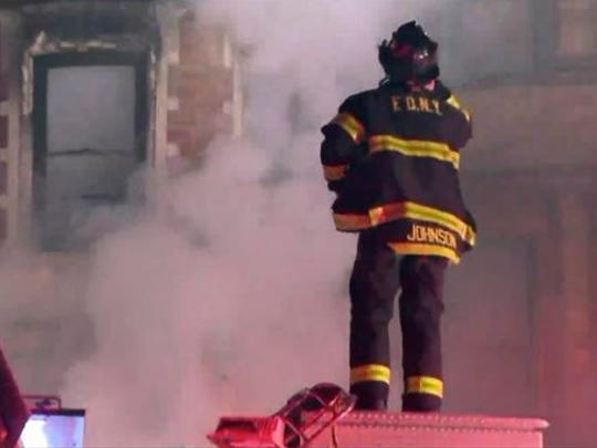 This photo provided by WPIX-11 shows New York firefighters