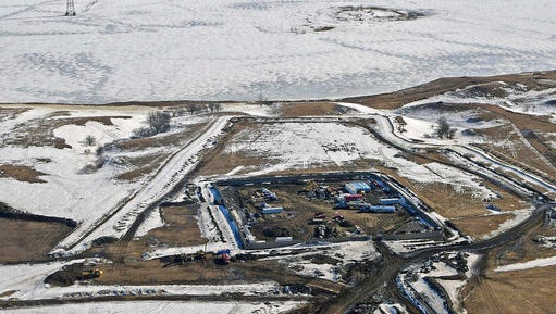 FILE - This Feb. 13, 2017, aerial file photo, shows a site where the final phase of the Dakota Access pipeline is taking place with boring equipment routing the pipeline underground and across Lake Oahe to connect with the existing pipeline in Emmons County near Cannon Ball, N.D. Federal Judge James Boasberg on Tuesday, March 14 denied a request by the Standing Rock and Cheyenne River Sioux to stop oil from flowing while they appeal his earlier decision allowing pipeline construction to finish.