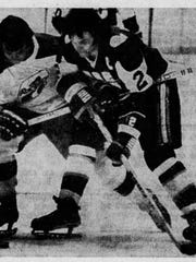 In this cutout from the Indianapolis Star on April 25, 1976, Racers forward Dave Keon moves in on New England's Rick Ley during a playoff game at Market Square Arena.