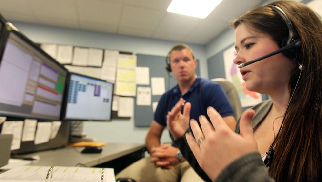 Kim Dernhagen, a Kenton County 911 dispatcher, trains Ian Byrne, who will become a dispatcher upon successfully completing the training program. They are in the Kenton County Emergency Communications Center in Independence.