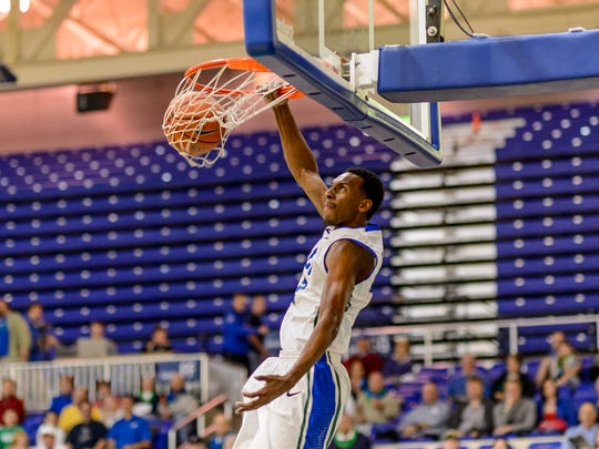 FGCU's all-time leading scorer, Bernard Thompson was known as a great pure shooter. But he also could throw down. (Note the rolled up Alico Arena seats that weren't necessary just months before the 2013 Dunk City Sweet 16 run).