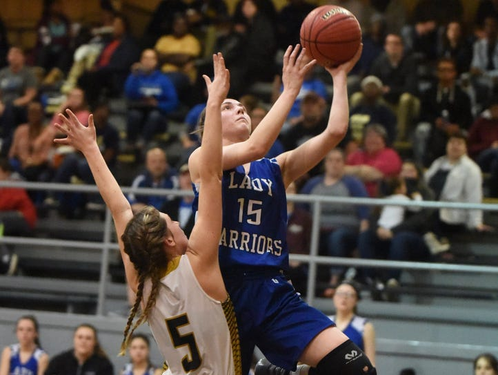 Cotter's Alexa Wooten goes up for a layup against Carlisle's