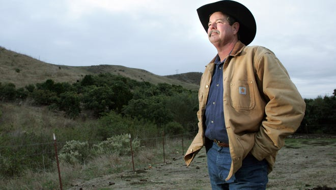Richard Atmore, owner of R.A. Atmore and Sons Ranch, looks out at the hills where his cows are grazing in 2011. An 860-acre parcel of Lloyd Ranch was donated to the Rancho San Buenaventura Conservation Trust, founded by Atmore, late last month.