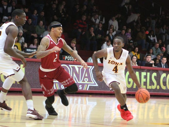 Iona's Schadrac Casimir attempts to drive past Rider's