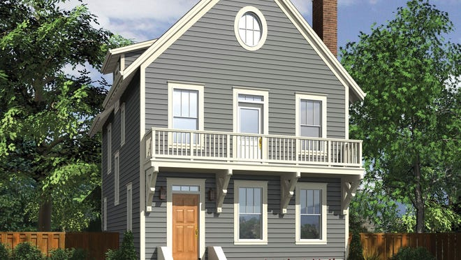 Wood siding and a sweet balcony make this traditional home design stand out.