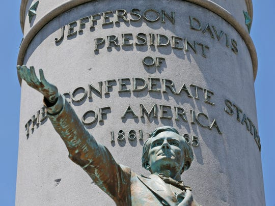 This June 28, 2017, shows statue of Confederate president Jefferson Davis on Monument Avenue in Richmond, Va. As cities across the United States are removing Confederate statues and other symbols, dispensing with what some see as offensive artifacts of a shameful past marked by racism and slavery, Richmond is taking a go-slow approach.