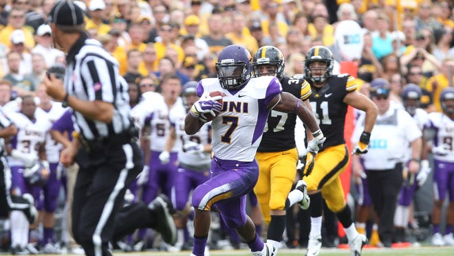 Northern Iowa Panthers running back David Johnson (7) runs away from the Iowa Hawkeyes defense for a touchdown at Kinnick Stadium. Iowa beat Northern Iowa 31-23.
