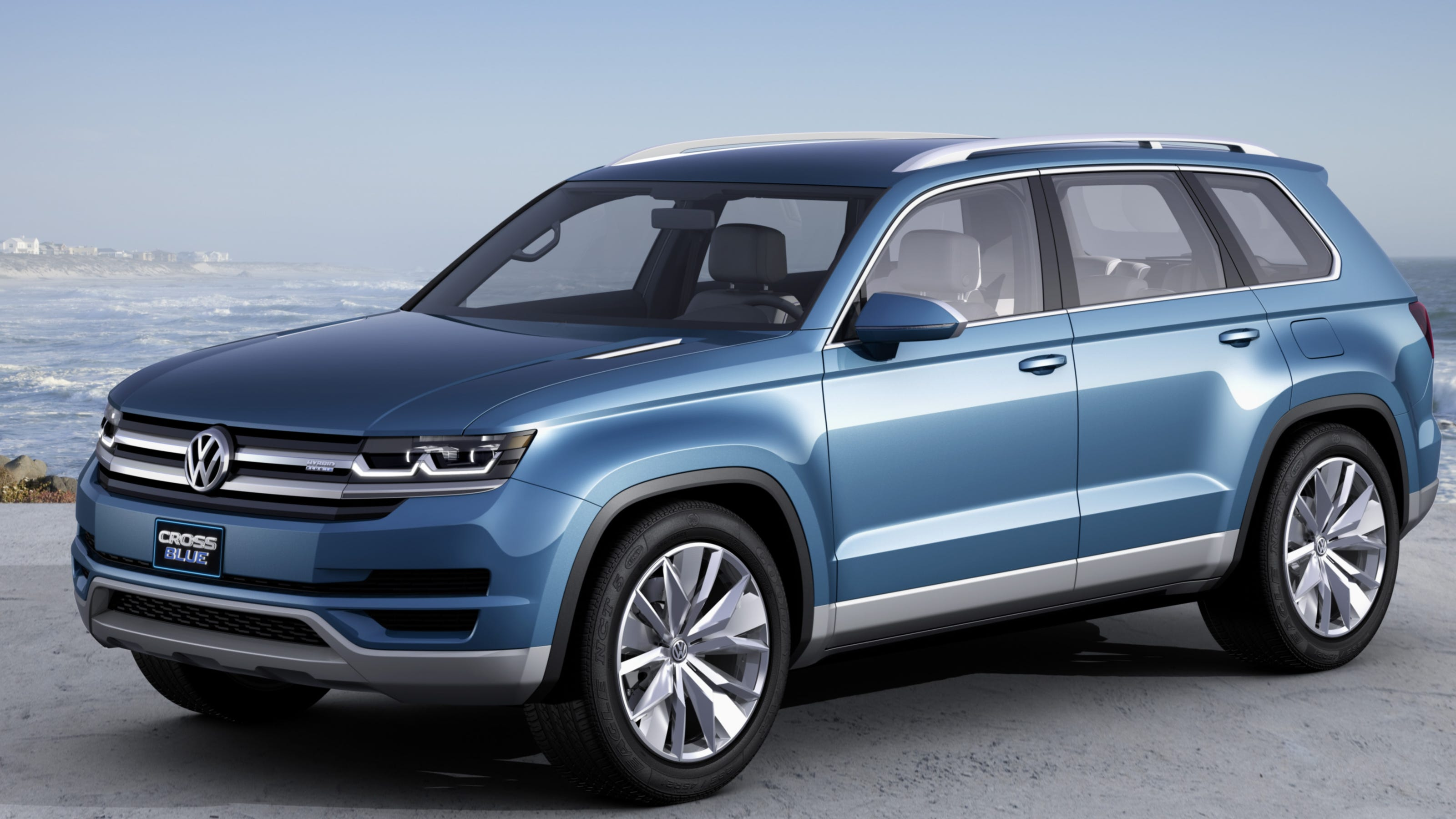 vw teases with diesel electric hybrid suv
