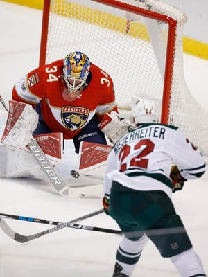 Minnesota Wild right wing Nino Niederreiter (22) attempts a shot at Florida Panthers goalie James Reimer (34) during the first period of an NHL hockey game, Friday, March 10, 2017, in Sunrise, Fla.