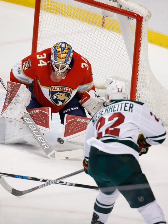 Minnesota Wild right wing Nino Niederreiter (22) attempts a shot at Florida Panthers goalie James Reimer (34) during the first period of an NHL hockey game, Friday, March 10, 2017, in Sunrise, Fla. (AP Photo/Wilfredo Lee)
