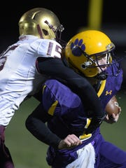 Hagerstown's Owen Golliher is hit by Indianapolis Lutheran's