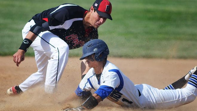 Stephen Decatur's Nick Bennett safely slides under the tag of Bennett's Simon Palenchar into 3rd base after advancing on a tag-up during play Monday afternoon.