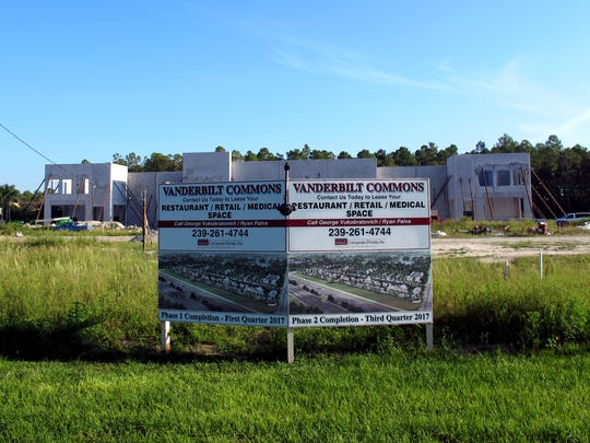 Vanderbilt Commons retail center will be built fronting Vanderbilt Beach Road just west of Collier Boulevard. Midgard Self Storage's three-story warehouse is under construction at the rear of the property.