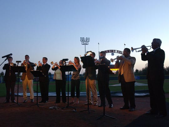 As the sun rises, the Triumphant Trumpets  kick off