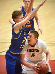 Connor Schoborg of Rocori drives to the basket during