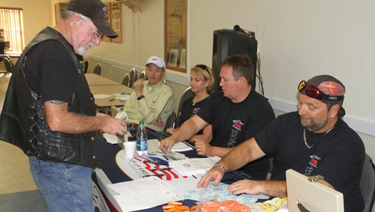 American Security Council Foundation's inaugural Poker run was April 7. Working the morning registration desk are, from left, Dr. Henry Fischer, Kristine McIntosh, John McIntosh, and a representative of American Legion Riders Post 39.