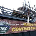 Renovations to Wrigley Field's left field bleachers and the addition of a jumbo video screen continue in Chicago. Ballparks are being designed with a greater emphasis on blending with the community, year-round use and providing smaller, more intimate gathering spaces in an effort to connect with fans, particularly millennials.