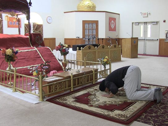 Pardeep Kaleka prays in the prayer hall at the Sikh Temple of Wisconsin.