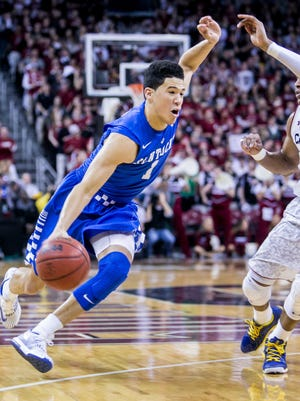 Jan 24, 2015; Columbia, SC, USA; Kentucky Wildcats guard Devin Booker (1) drives around South Carolina Gamecocks guard Tyrone Johnson (4) in the first half at Colonial Life Arena. Mandatory Credit: Jeff Blake-USA TODAY Sports