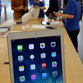 """Customers browse Apple's new """"iPad Air"""" tablets at an Apple store in Tokyo on November 1, 2013. Over 300 customers queued up for the new slim iPad Air as the tablet launched worldwide."""