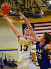 Merrol Hyde Magnet junior Connor Dunn elevates for a layin over Clarksville Academy's Jason McClendon during first-quarter action