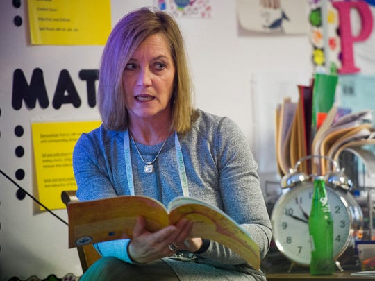 """Lisa Porter of Newburgh, reads in her third grade class """"My Mouth Is a Volcano!"""" by Julia Cook at Sharon Elementary in Newburgh, Tuesday, March 7, 2017."""