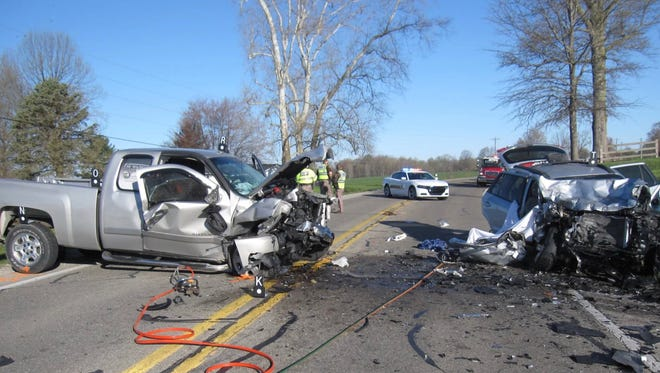 Three members of a family on their way to a softball tournament died in a crash in Monroe County Sunday.