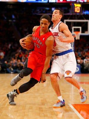 Toronto guard DeMar DeRozan drives to the basket Wednesday against Knicks guard Pablo Prigioni at Madison Square Garden.