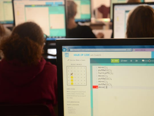 Students learn basic Javascript at North Middle School on Friday in order to learn how to make computer animation.