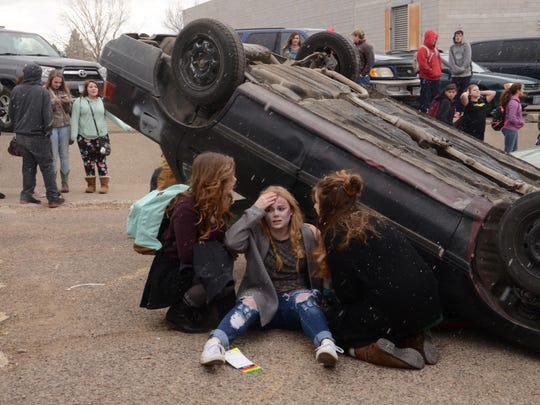 Students participate in a 2016 simulation at Great Falls High of what can happen when teenagers choose to drink and drive.