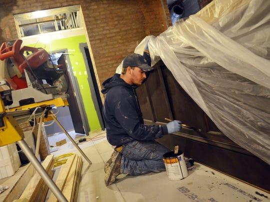 Ben Barten of Corridor Construction stains the future