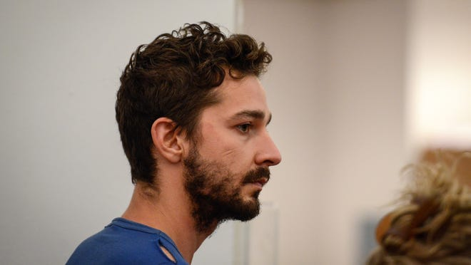 Shia LaBeouf, represented by a Legal Aid attorney, is arraigned in Midtown Community Court, in New York, Friday, June 27, 2014. LaBeouf was released from police custody Friday after he was escorted from a Broadway theater for yelling obscenities and continued to act irrationally while being arrested, authorities said. He's due back in court July 24. (AP Photo/Daily News, Anthony DelMundo, Pool)
