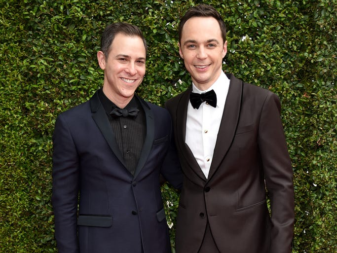 IMAGE DISTRIBUTED FOR THE TELEVISION ACADEMY - Todd Spiewak, left, and Jim Parsons arrives at the 66th Primetime Emmy Awards at the Nokia Theatre L.A. Live on Monday, Aug. 25, 2014, in Los Angeles. (Photo by John Shearer/Invision for the Television Academy/AP Images)