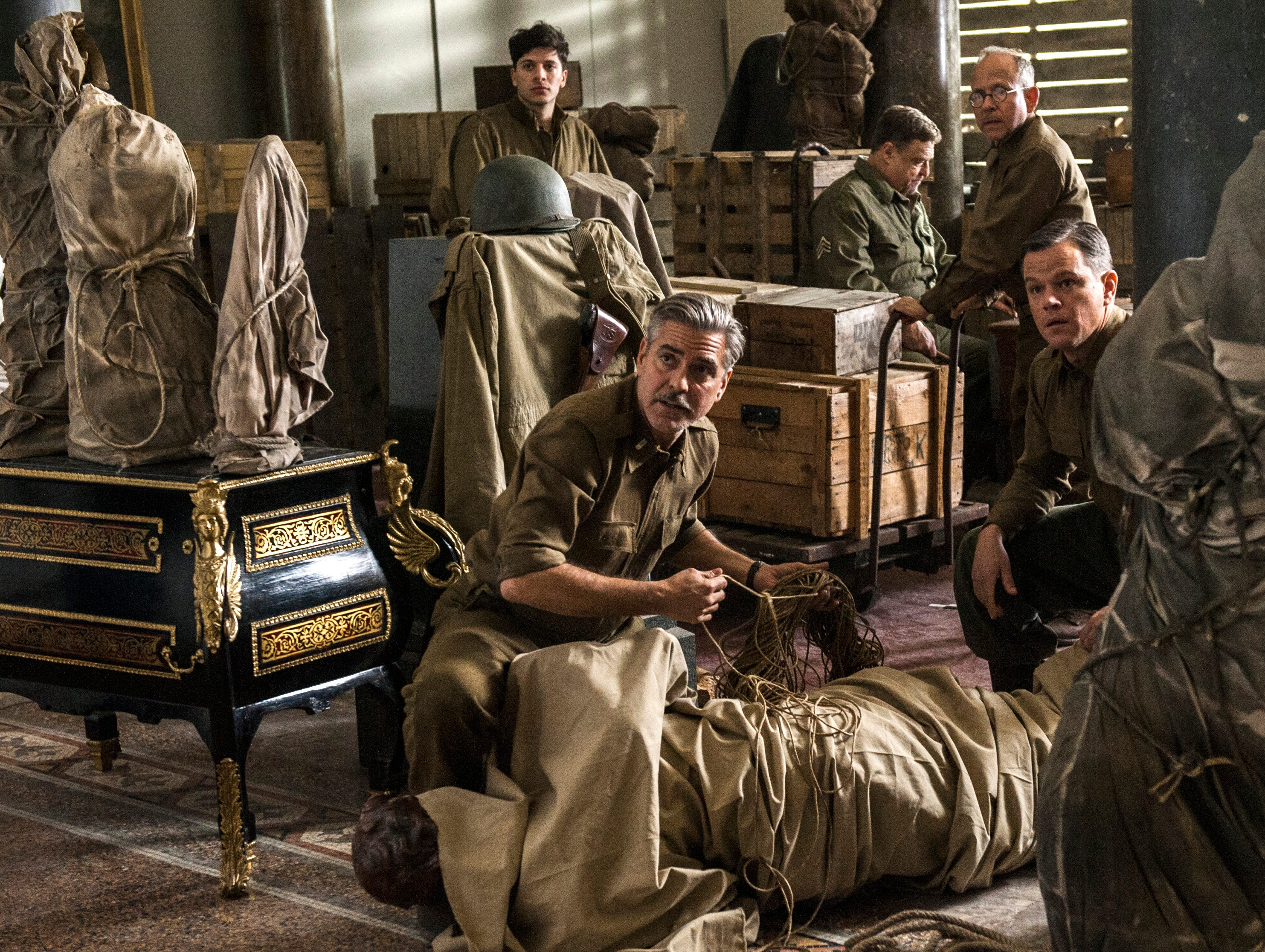 George Clooney, clockwise from front left, Sam Epstein, John Goodman, Bob Balaban and Matt Damon star in 'The Monuments Men,' based on the true story of a World War II troop of art experts searching for stolen masterpieces.