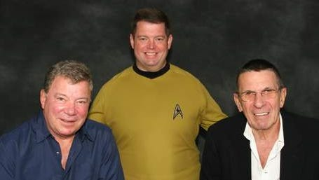 """Dave Arland, a Carmel public relations pro and  incurable """"Star Trek"""" fan, is shown with two of his heroes: original """"Star Trek"""" stars William Shatner and Leonard Nimoy."""