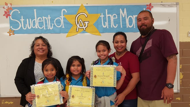 The Guahan Academy Charter School honored its December Student of the Month awardees on Jan 11. Pictured front row from left: Mary Mafnas, Dean of Elementary School Guahan Academy Charter School; Iliyah Rengiil; Amelia Rengiil; Alayna Rengiil: Shara and Bernard Santos.
