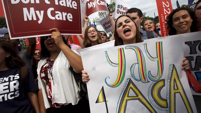 "Jessica Ellis, right, holds a sign that says ""Yay 4 ACA,"" as she and other supporters of the Affordable Care Act react with cheers as the opinion for health care is reported outside of the Supreme Court in Washington, on Thursday, June 25."