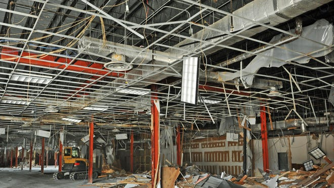 Demolition at Titusville's Miracle City Mall resumed this week. AG Development Group plans a $60 million shopping complex called Titus Landing at the location.