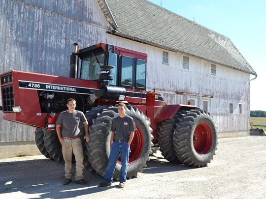 Brothers Hunter, left, and Cody Haar run two successful agriculture businesses by themselves — a 550-acre farm and Haar Brothers Equipment.