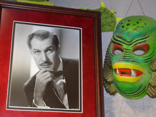 "Evelyn Dorn's monster display at Clyde Public Library includes this photo of Vincent Price and this toy mask based on the movie ""Creature from the Black Lagoon."""