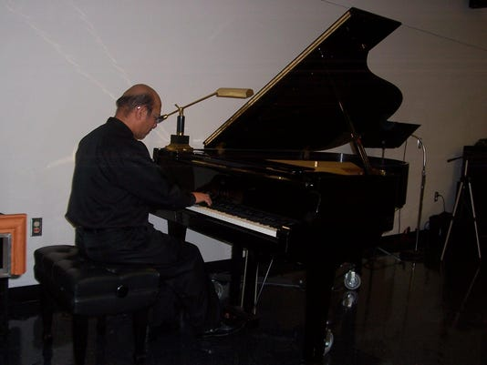 Roy playing piano