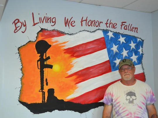 Wilson Aaron painted this mural on the wall of VFW post's Port Clinton office in honor of soldiers both current and past, and those who survived and those never came home.