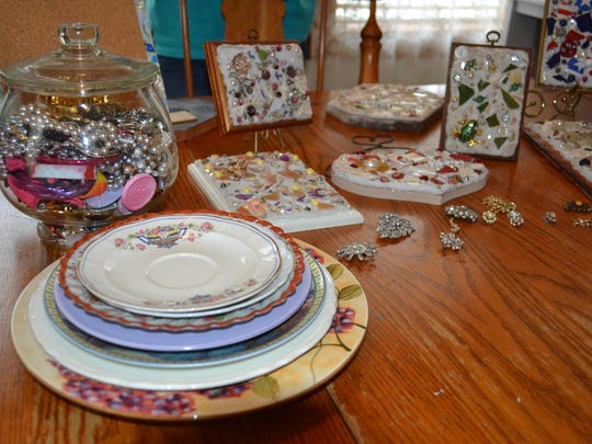 Grace Bolling uses old decorative plates and vintage jewelry she picks up at Goodwill and garage sales in her handmade mosaics.