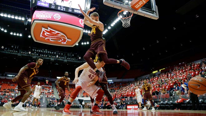 Washington State center Conor Clifford (42) tries to get out of the way of a leaping Arizona State guard Kodi Justice after Clifford was fouled on a play in the first half of an NCAA college basketball game, Saturday, Feb. 18, 2017, in Pullman, Wash.