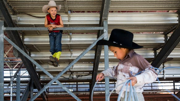 Brace Miller, 6, left, watches as Koty Gopher, 6, right,