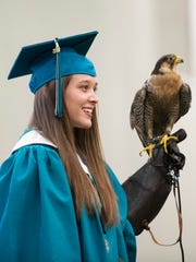 Taylor Cotton holds Lillian a falcon during the Jensen