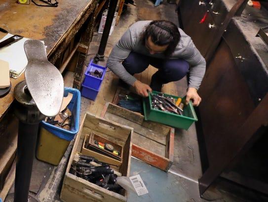 Anthony Pappalardo sorts through the cobbler tools