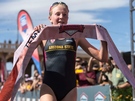 Hannah Henry crosses the finish line first during the