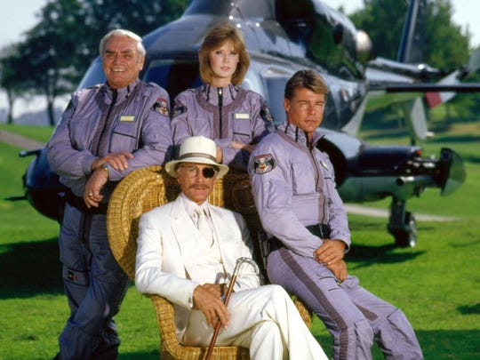 Cast of 'Airwolf' Ernest Borgnine, Jean Bruce Scott, Jan-Michael Vincent, and Alex Cord seated---CBS publicity photo.
