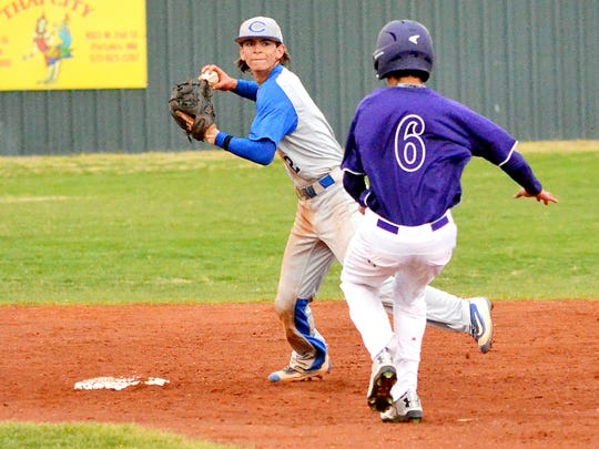 Carlsbad shortstop Ryan Razo forces out Clovis courtesy runner Joe Gallegos and makes the turn on a 1-6-3 double play in the opening game of Friday's District 4-6A doubleheader at Bell Park in Clovis.